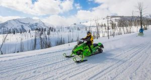 A Winter Snowmobiling Vacation Provides Great Family Bonding Time